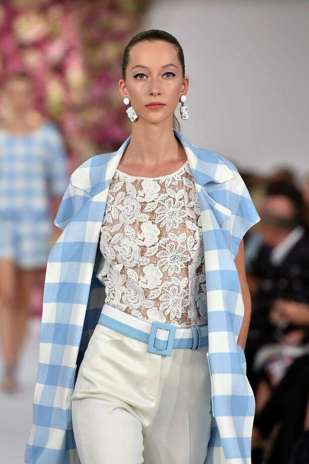 Gingham is predicted to be the print of the spring season in dresses, skirts, tops, jackets and long coats as seen in this look from Oscar de la Renta. Photo: Slaven Vlasic / Getty Images / 2014 Getty Images