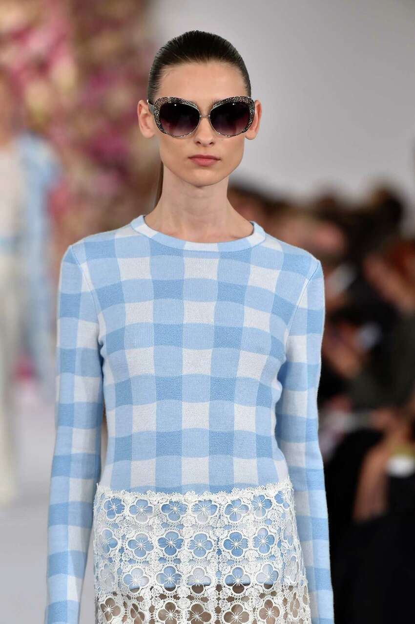 Gingham is predicted to be the print of the spring season in dresses, skirts, tops, jackets and long coats as seen in this look from Oscar de la Renta.