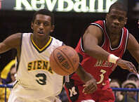 Times Union Photo by James Goolsby-Feb. 21, 2001-(L. to R.)- Siena College #3-Prosper Karangwa battles Marist #33-Drew Samuels for the loose ball.