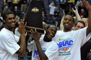 Siena seniors Edwin Ubiles, Ronald Moore, and Alex Franklin hold the trophy after winning their third straight MAAC Tournament, a 72-65 overtime victory over Fairfield at the Times Union Center in Albany, NY on Monday night March 8, 2010.  (Philip Kamrass / Times Union)