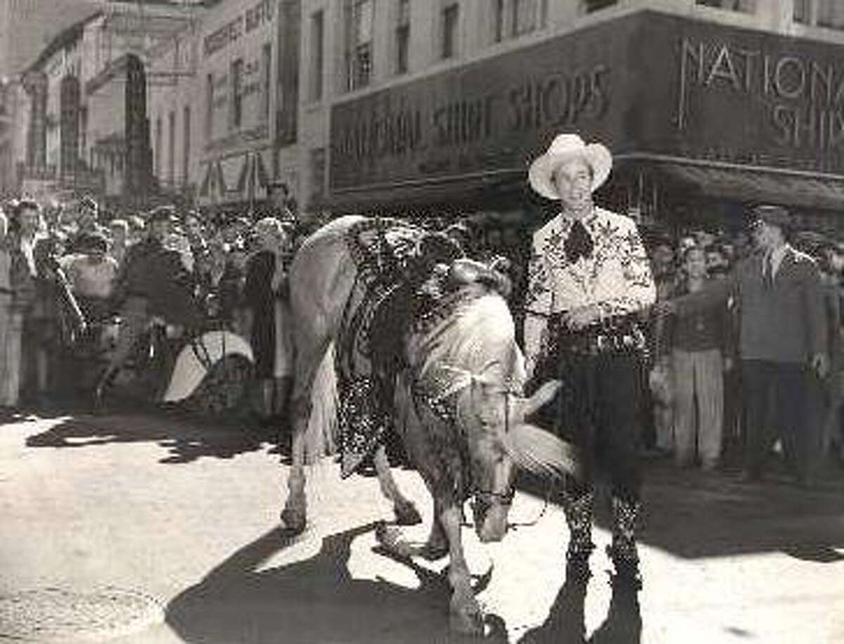 Roy Rogers is pictured on St. Mary's Street at the intersection of Houston Street during his February 1943 visit. Rogers and Trigger both reportedly stayed at the Gunter Hotel.