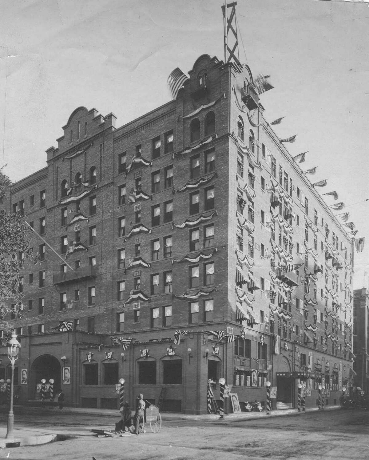 The St. Anthony Hotel is shown decked out in flags, bunting and pictures of President William Howard Taft in celebration of his visit to San Antonio on Oct. 17, 1909. Taft stayed at the hotel. Published in the Express, October 17, 1909.