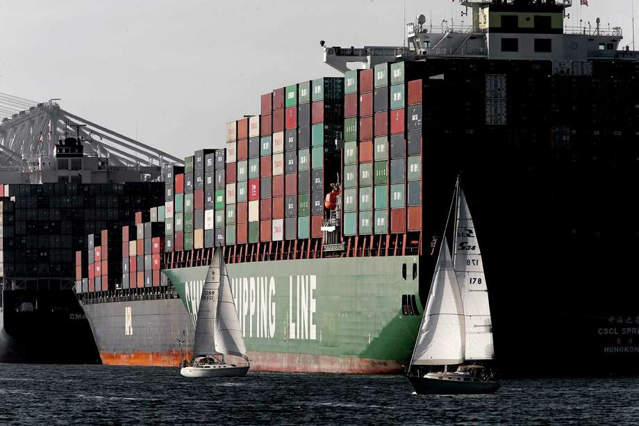 A labor dispute at West Coast ports that stranded cargo offshore dealt a setback to sales of new vehicles. Photo: Michael Macor / The Chronicle / ONLINE_YES