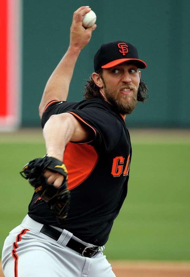 San Francisco Giants' Madison Bumgarner pitches in 1st inning against Oakland Athletics in Cactus League opener at Hohokam Stadium in Mesa, Arizona, on Tuesday, March 3, 2015. Photo: Scott Strazzante / The Chronicle / ONLINE_YES