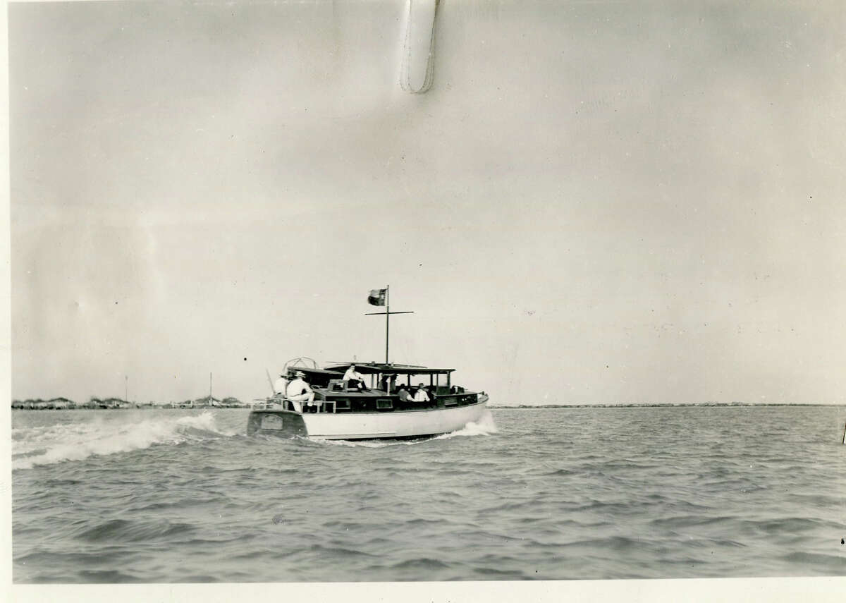 Texas Governor Ross Sterling takes a party out to fish on one of the state cruisers. (1931)