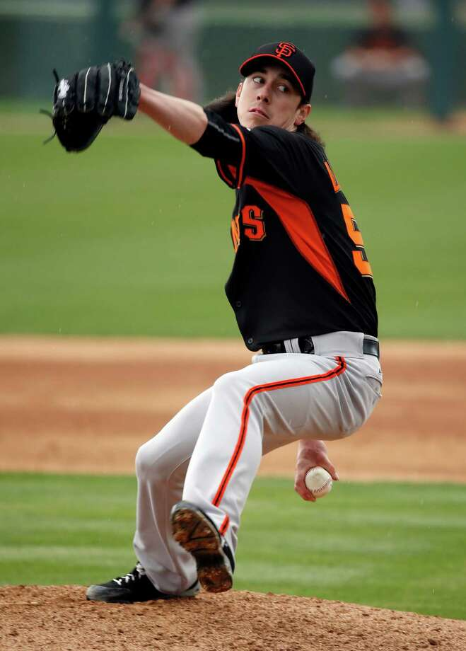 The Giants' Tim Lincecum pitches in the third inning against the Oakland A's in the Cactus League opener at Hohokam Stadium in Mesa, Ariz., on March 3, 2015. Photo: Scott Strazzante / The Chronicle / ONLINE_YES