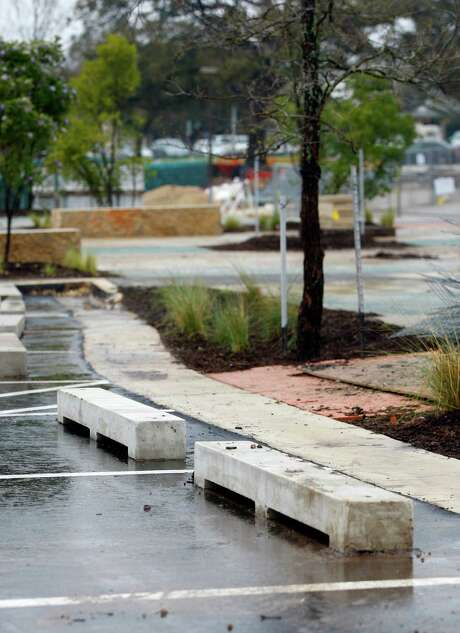 Special curbs are seen Tuesday, March 3, 2015 at the still-under-construction DoSeum on Broadway. The curbs are designed to allow water to pass under them so it can enter a bioswale. Photo: William Luther, Staff / San Antonio Express-News / © 2015 San Antonio Express-News