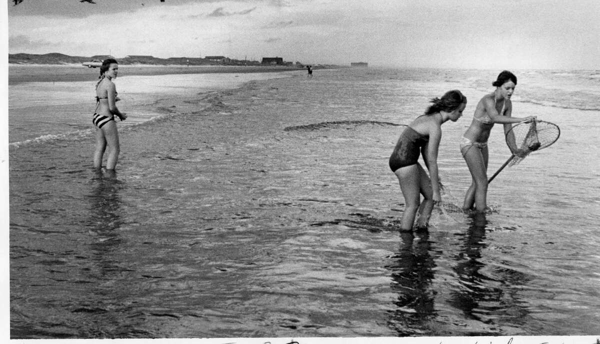 What are they doing? Catching sand crabs in 1979.