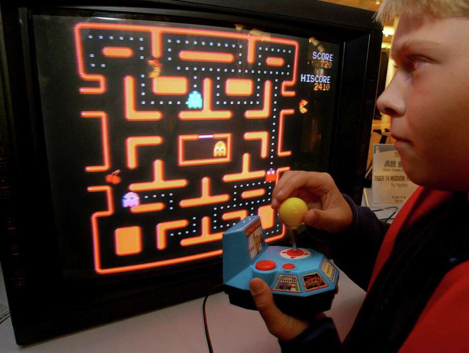 """Google scientists have cooked up software that can do better than humans on dozens of Atari video games from the 1980s, including """"Space Invaders."""" But """"Ms. Pac-Man"""" (left) requires too much planning. Photo: Richard Drew / Associated Press / AP"""