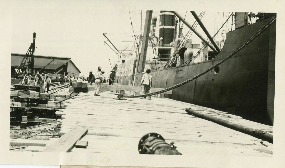 Men unload lumber from the S.S. Florence Luckenbach at Port Aransas, Monday, July 9, 1923.
