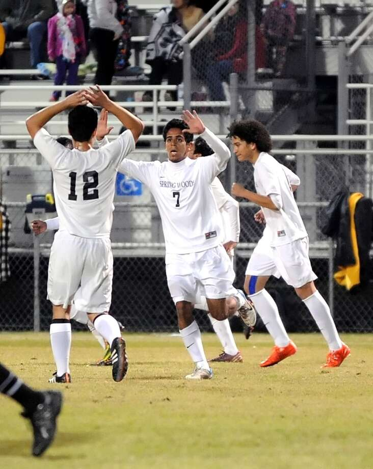 Houston Stratford visited Spring Woods for a UIL District 19-5A boys soccer game, 2-6-15. Right, Spring Woods's Christian Hinojosa (7) scored a goal and celebrates with teammate gorge Fernandez (18). Photo: Eddy Matchette, Freelance / Freelance