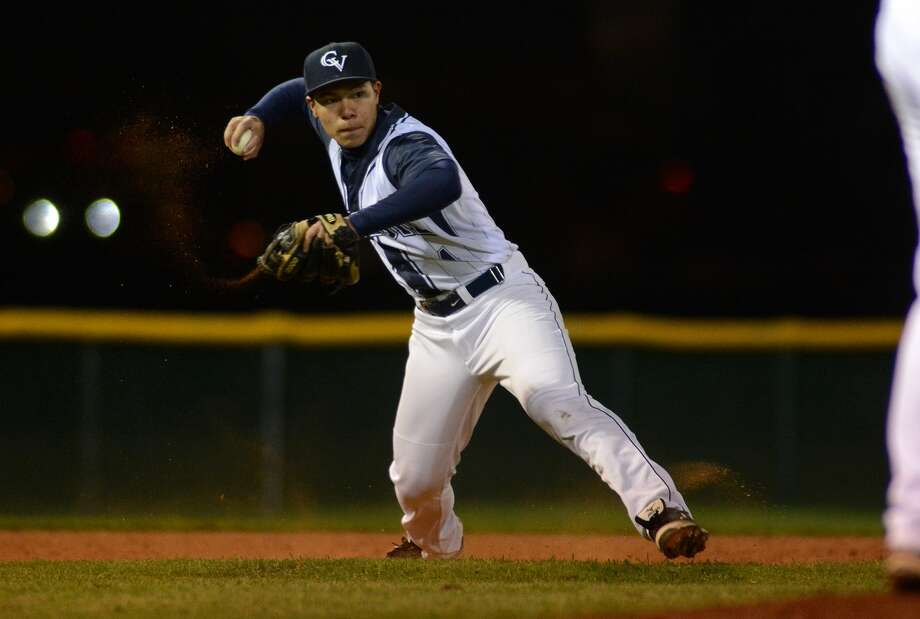 Carnegie Vanguard third baseman Albert Yun makes a play against Westside during their season opener at Leeroy Ashmore Field on Feb. 24. Photo: Jerry Baker, Freelance
