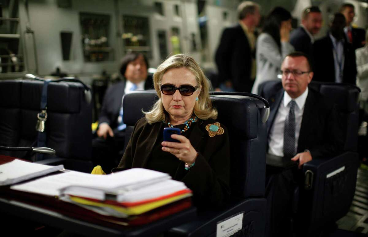 Then-Secretary of State Hillary Clinton checks her Blackberry in October 2011 from a desk inside a C-17 military plane upon her departure from Malta, in the Mediterranean Sea, bound for Tripoli, Libya. Clinton used a personal email account during her time as secretary of state, rather than a government-issued email address, potentially hampering efforts to archive official government documents required by law. Clinton's office said nothing was illegal or improper about her use of the non-government account and that she believed her business emails to State Department and other .gov accounts would be archived in accordance with government rules.