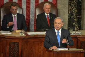 Israeli Prime Minister Benjamin Netanyahu speaks before a joint meeting of Congress on Capitol Hill in Washington on March 3. Behind him are House Speaker John Boehner, R-Ohio, left, and Sen. Orrin Hatch, R-Utah. Illustrates NETANYAHU (category w), by Steven Mufson and Katie Zezima (c) 2015, The Washington Post. Moved Tuesday, March 3, 2015. (MUST CREDIT: Washington Post photo by Bill O'Leary)