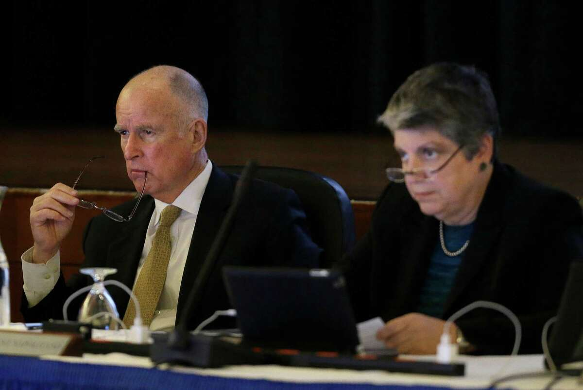 In this file photo from Wednesday, Jan. 22, 2014, California Gov. Jerry Brown, left, and University of California president Janet Napolitano listen to speakers during a UC Board of Regents meeting in San Francisco.