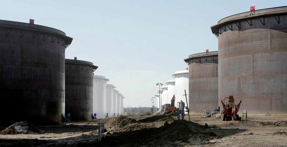 Although crude inventories overall dropped last week, stockpiles at Cushing, Oklahoma, the biggest U.S. oil storage hub, climbed to a record, Energy Information Administration data show. Photo: Associated Press File Photo / Tulsa World