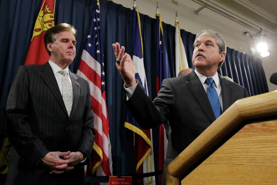 Lt. Gov. Dan Patrick, left,  and Senate Education Committee Chairman Larry Taylor, present bill ideas including a plan to issue A-F grades for individual public schools and to expand online learning. Photo: Eric Gay, STF / AP