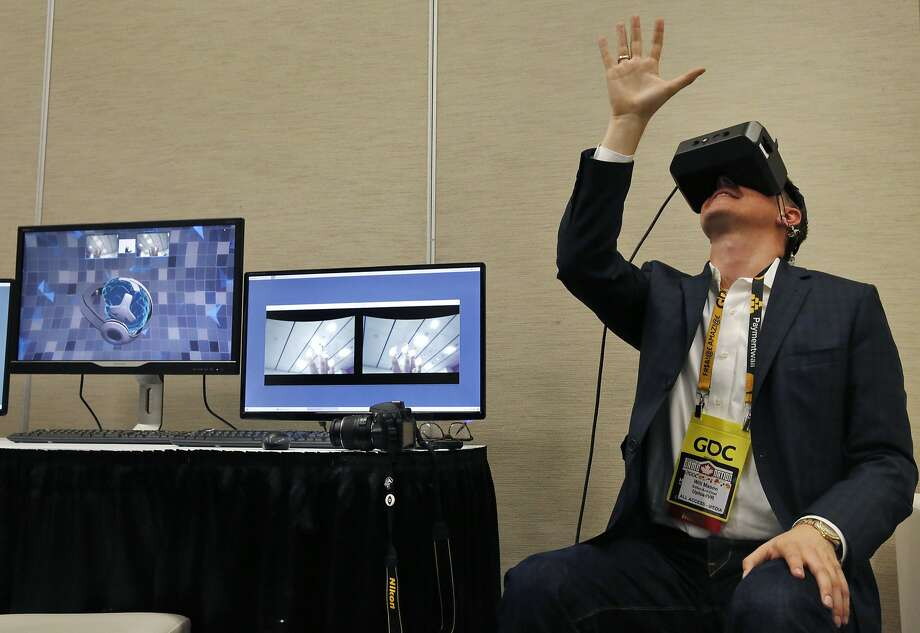 Will Mason with Upload VR, tries out the new MindLeap neurogoggles during the Game Developers Conference at Moscone Center South March 3, 2015 in San Francisco, Calif. Photo: Leah Millis, The Chronicle