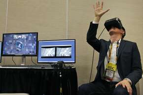 Will Mason with Upload VR tries out the new MindLeap neuro-goggles during the conference.