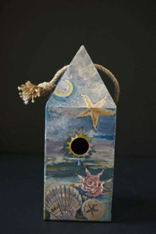"""Eileen Carnes Foster, of Fairfield, designed her """"Gimme Shelter"""" birdhouse to be auctioned off at this year's Project Return fundraiser March 19. Photo: Contributed Photo, Lorin Klaris / Westport News"""