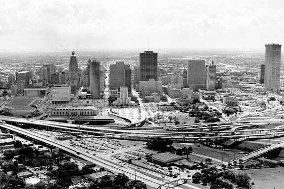 08/1967 - aerial of downtown Houston skyline. Buildings include Jones Hall, the Gulf Building, US Federal Courthouse, Sam Houston Coliseum, Houston City Hall, Bank of the Southwest, Tenneco building, Houston Public Library, Sheraton Lincoln Hotel, and the Humble building. Also Sam Houston Park and the Fonde Recreation Center (building in foreground).