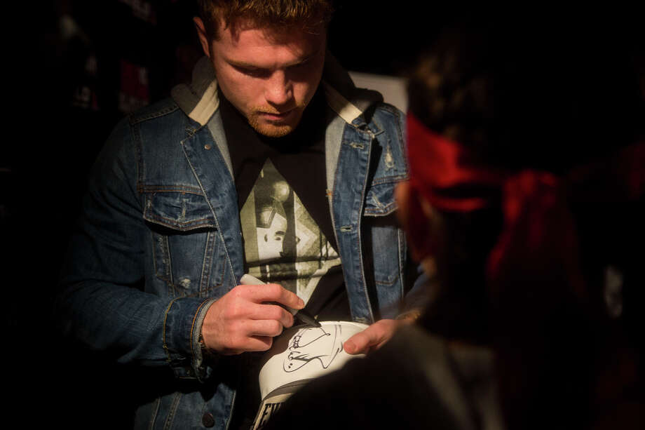 "Saul ""Canelo"" Alvarez signs an autograph for Danielle Contreras, 10, during a media event promoting the May 9th Alvarez vs. James Kirkland boxing match at Aztec Theater in San Antonio, TX on Tuesday, March 3, 2015. Contreras has been a fan since she was 7 years old and is a boxer herslef. Photo: Carolyn Van Houten /San Antonio Express-News / San Antonio Express-News"