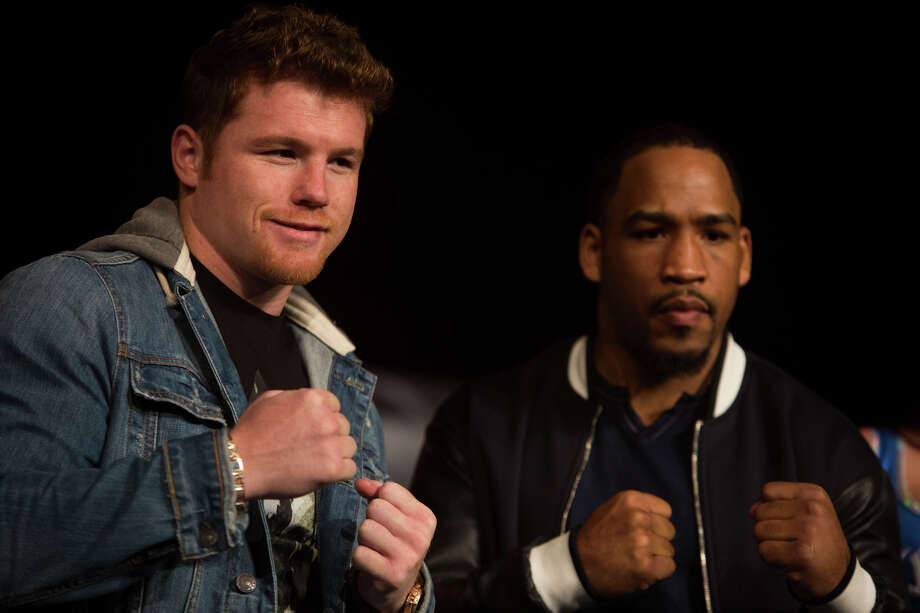 "Saul ""Canelo"" Alvarez and James Kirkland pose for the media during an event promoting their May 9th boxing match at Aztec Theater in San Antonio, TX on Tuesday, March 3, 2015. Photo: Carolyn Van Houten, Staff / San Antonio Express-News / 2015 San Antonio Express-News"