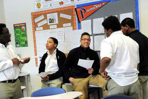 """Eighth-grade students discuss a topic related to the book """"Unbroken,"""" which they recently read, during their English Language Arts class on Tuesday, March 3, 2015, at Brighter Choice Middle School for Boys in Albany, N.Y. (Cindy Schultz / Times Union) Photo: Cindy Schultz / 00030801A"""