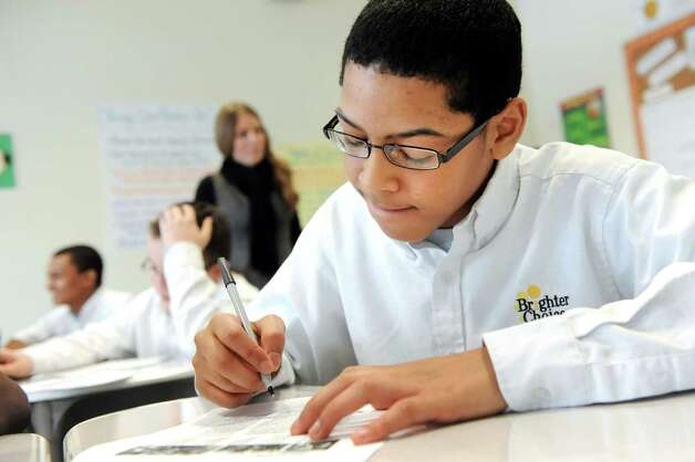Kyjaun Stanfield, 13, works with another student in his eighth-grade English Language Arts class on Tuesday, March 3, 2015, at Brighter Choice Middle School for Boys in Albany, N.Y. (Cindy Schultz / Times Union) Photo: Cindy Schultz / 00030801A