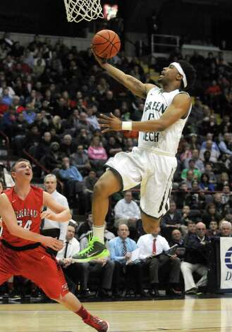 Green Tech's Israel Griffin goes to the basket during their Class AA Boys' Basketball Semifinals against Guilderland at the Times Union Center on Tuesday March 3, 2015 in Albany, N.Y. (Michael P. Farrell/Times Union) Photo: Michael P. Farrell / 00030790A