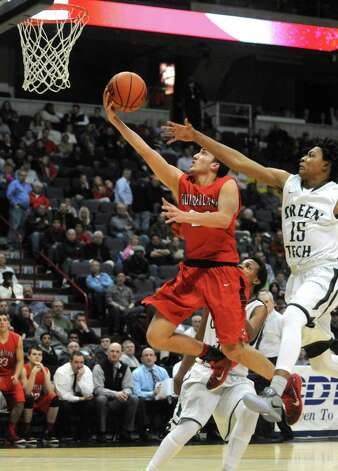 Guilderland's Ralph Simeone goes to the basket during their Class AA Boys' Basketball Semifinals against Green Tech at the Times Union Center on Tuesday March 3, 2015 in Albany, N.Y. (Michael P. Farrell/Times Union) Photo: Michael P. Farrell / 00030790A