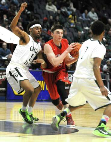 Guilderland's Andrew Platek looks to pass during their Class AA Boys' Basketball Semifinals against Green Tech at the Times Union Center on Tuesday March 3, 2015 in Albany, N.Y. (Michael P. Farrell/Times Union) Photo: Michael P. Farrell / 00030790A