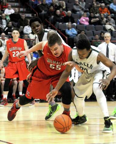 Guilderland's Andrew Sischo and Green Tech's Anquon McLean battle for a rebound during their Class AA Boys' Basketball Semifinals at the Times Union Center on Tuesday March 3, 2015 in Albany, N.Y. (Michael P. Farrell/Times Union) Photo: Michael P. Farrell / 00030790A