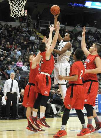 Green Tech's Anquon McLean goes to the basket during their Class AA Boys' Basketball Semifinals against Guilderland at the Times Union Center on Tuesday March 3, 2015 in Albany, N.Y. (Michael P. Farrell/Times Union) Photo: Michael P. Farrell / 00030790A