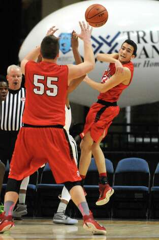 Guilderland's Ralph Simeone passes the ball off to teammate Andrew Sischo during their Class AA Boys' Basketball Semifinals against Green Tech at the Times Union Center on Tuesday March 3, 2015 in Albany, N.Y. (Michael P. Farrell/Times Union) Photo: Michael P. Farrell / 00030790A