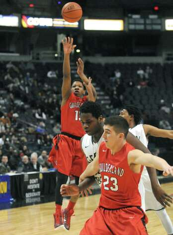 Guilderland's Michael Henderson puts up a shot during their Class AA Boys' Basketball Semifinals against Green Tech at the Times Union Center on Tuesday March 3, 2015 in Albany, N.Y. (Michael P. Farrell/Times Union) Photo: Michael P. Farrell / 00030790A