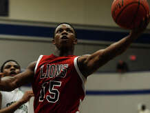 Kountze's Grayland Arnold, No. 15, goes up for a basket during Tuesday's game against Hempstead. The Kountze Lions played the Hempstead Bobcats at Barbers Hill High School on Tuesday in the Region 3 3A regional quarterfinal playoffs.  Photo taken Tuesday 3/3/15  Jake Daniels/The Enterprise