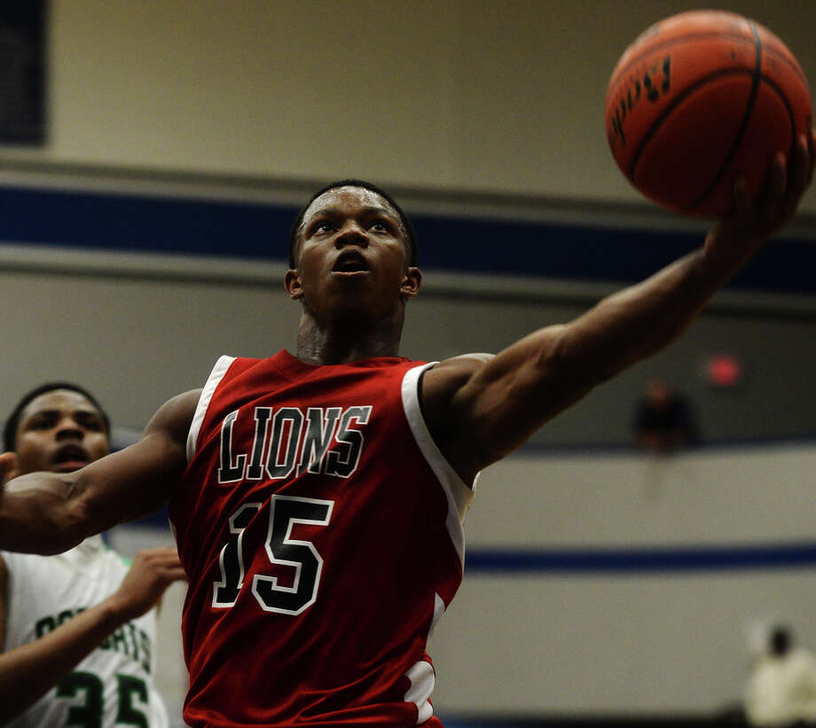 Kountze's Grayland Arnold, No. 15, goes up for a basket during Tuesday's game against Hempstead. The Kountze Lions played the Hempstead Bobcats at Barbers Hill High School on Tuesday in the Region 3 3A regional quarterfinal playoffs. Photo taken Tuesday 3/3/15 Jake Daniels/The Enterprise Photo: Jake Daniels / ©2015 The Beaumont Enterprise/Jake Daniels