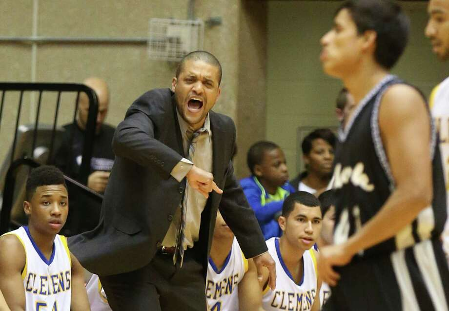 Clemens coach Clifton Ellis directs his team against Clark in Region IV-6A quarterfinals at UTSA on March 3, 2015. Photo: Kin Man Hui /San Antonio Express-News / ©2015 San Antonio Express-News