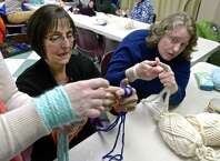 Kathy Bopp, left, and Ellen Waltimyer, both from New Fairfield, watch as Heather Nunes Heather Nunes demonstrates arm knitting during a class Nunes was teaching at the New Fairfield Public Library on Friday night, February 27, 2015, in New Fairfield, Conn. Arm knitting replaces knitting needles with your hands and arms.
