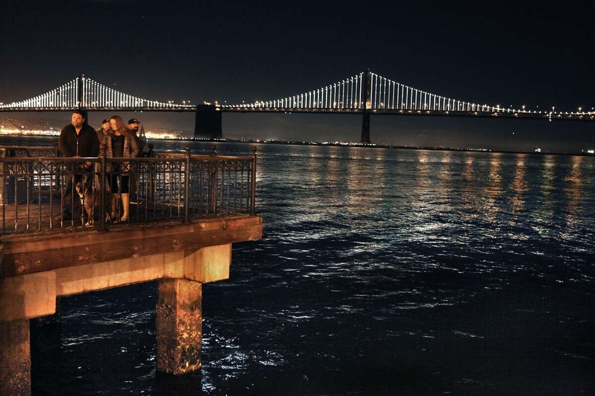 The Bay Lights seen from Pier 7 in San Francisco, California, on Friday, November 15, 2013. The Bay Bridge will host the light sculpture, designed by artist Leo Villareal until March of 2015.