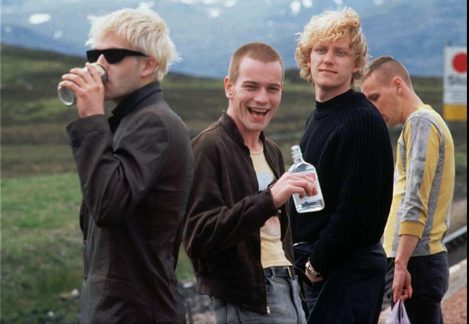 "Johnny Lee Miller, from left, Ewan McGregor and Kevin McKidd star in ""Trainspotting."" Photo: DANIEL LIAM, HO / Warner Bros."