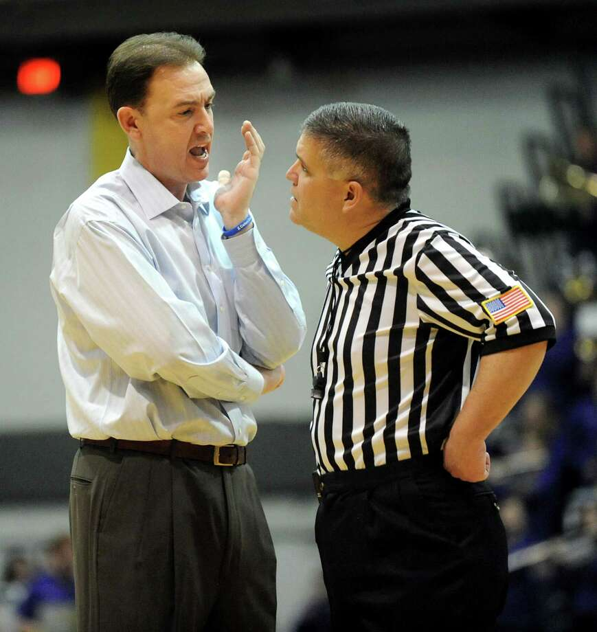 UAlbany's coach Will Brown, left, has a discussion with an official during their basketball game against Hartford on Friday, Feb. 20, 2015, at SEFCU Arena in Albany, N.Y. (Cindy Schultz / Times Union) Photo: Cindy Schultz / 00030640A
