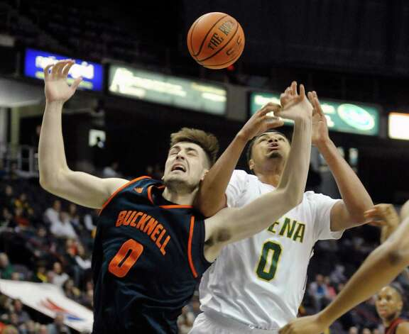 D.J. MacLeay, left, of Bucknell, and Javion Ogunyemi battle for a rebound during their game at the Times Union Center on Sunday, Dec. 28, 2014, in Albany, N.Y.  (Paul Buckowski / Times Union) Photo: Paul Buckowski / 00029973B