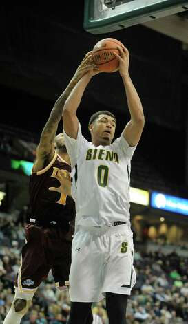 Javion Ogunyemi of Siena grabs a rebound during their game against Iona at the Times Union Center on Sunday, Jan. 4, 2014, in Albany, N.Y.   (Paul Buckowski / Times Union) Photo: Paul Buckowski / 00030029A