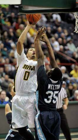 Javion Ogunyemi of Siena puts up a shot during their game against Saint Peter's at the Times Union Center on Sunday, Jan. 25, 2014, in Albany, N.Y.    (Paul Buckowski / Times Union) Photo: Paul Buckowski / 00030241B