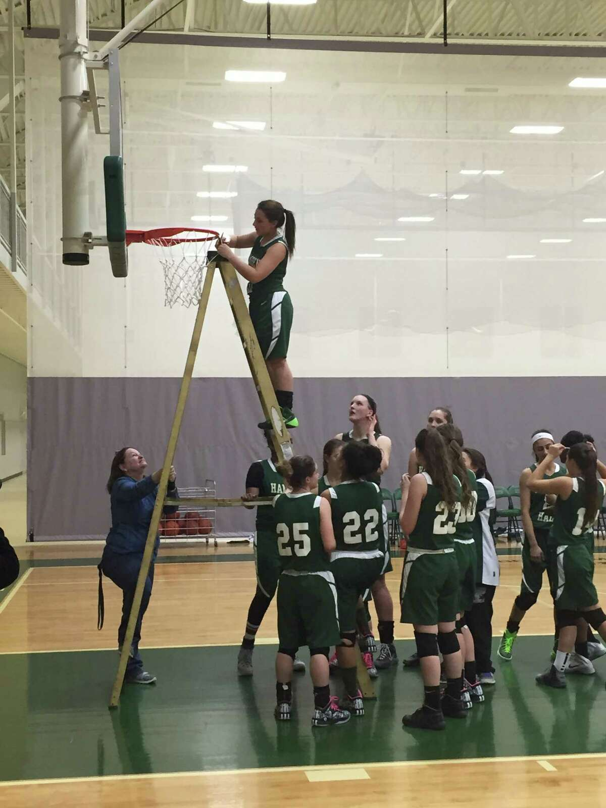 Hamden girls cut down the net at the Hamden Hall Athletic Complex following their 66-44 victory over St. Luke's to claim their second straight FAA title.