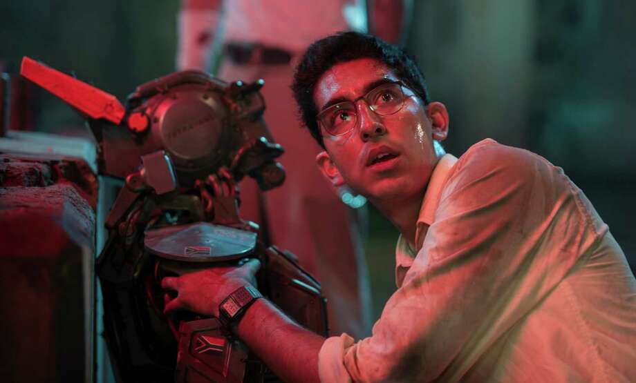 "This image released by Columbia Pictures shows Dev Patel in a scene from ""Chappie."" (AP Photo/Columbia Pictures, Stephanie Blomkamp) ORG XMIT: NYET131 Photo: Stephanie Blomkamp / Columbia Pictures"