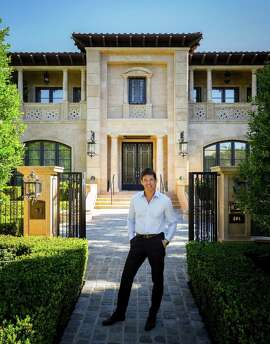 "Richard Landry, an architect, in front of a Tuscan villa he designed in Beverley Hills, Calif., Feb. 16, 2015. Landry has become perhaps the most sought-after, high-end residential architect in Los Angeles, but at upwards of 40,000 square feet, his larger projects have also garnered criticism for being over-the-top ""megamansions."""
