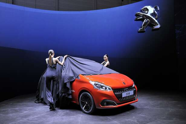 GENEVA, SWITZERLAND - MARCH 03:  The new Peugeot 208 is unveiled during the 85th International Motor Show on March 3, 2015 in Geneva, Switzerland. The 85th International Motor Show held from the 5th to 15th March 2015 will showcase novelties of the car industry.  (Photo by Harold Cunningham/Getty Images)